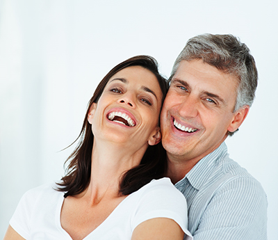 Smiling couple who received Prosthodontic Services in Walnut Creek, CA